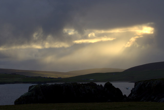 Sun bursting through the evening clouds from Lamba Ness