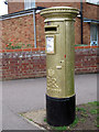 TL3602 : Laura Trott's Gold Post Box by Oast House Archive