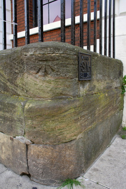 Benchmark at corner of Westgate and Bank Street