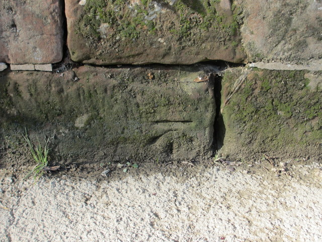 Bench mark on the riverside wall