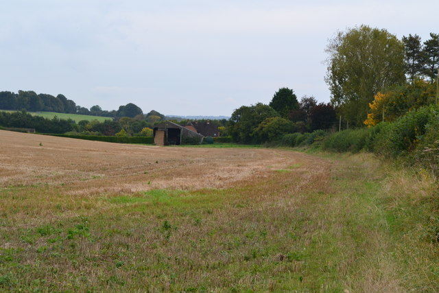 View across field towards Woodgate Farmhouse