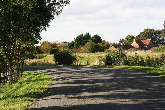 Manor Farm, seen across the Long Eau from Thacker Bank