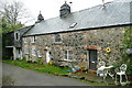 SX6961 : Cottages at Lutton by Graham Horn