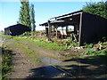 TL2778 : Barns near Broughton by Marathon