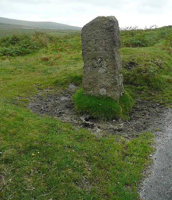 Boundary stone by the roadside