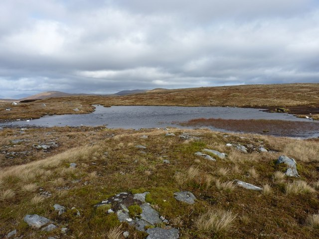 Shallow peaty lochan near the summit of Meall Phubuill