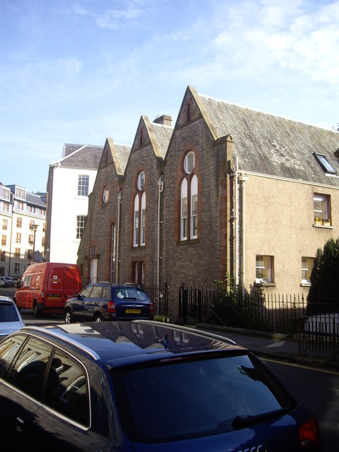 A triple-roofed building in St Stephen Street