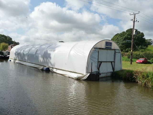 Floating polytunnel boatshed near bridge 57