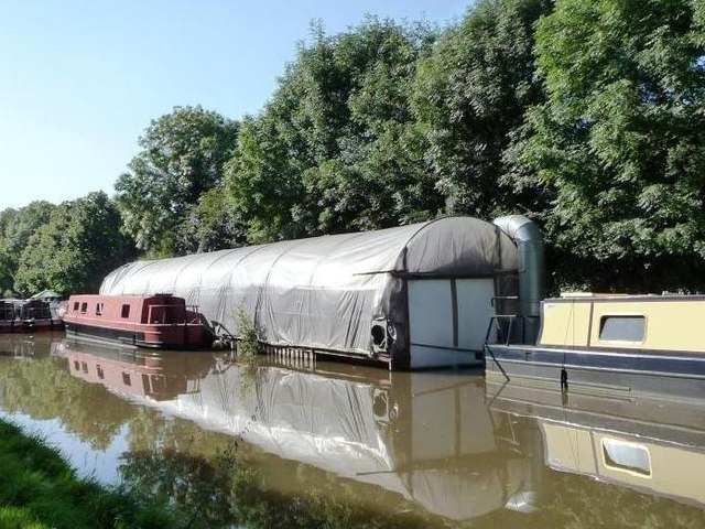 Floating polytunnel boatshed east of Stoke Wharf