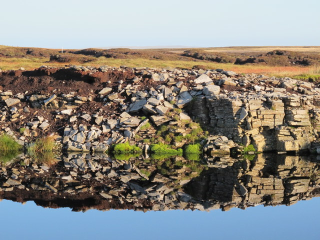 Reflections in the pond in disused quarry north of Pikeman Hill