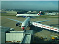 TQ2741 : British Airways planes near stand 57 by Richard Humphrey