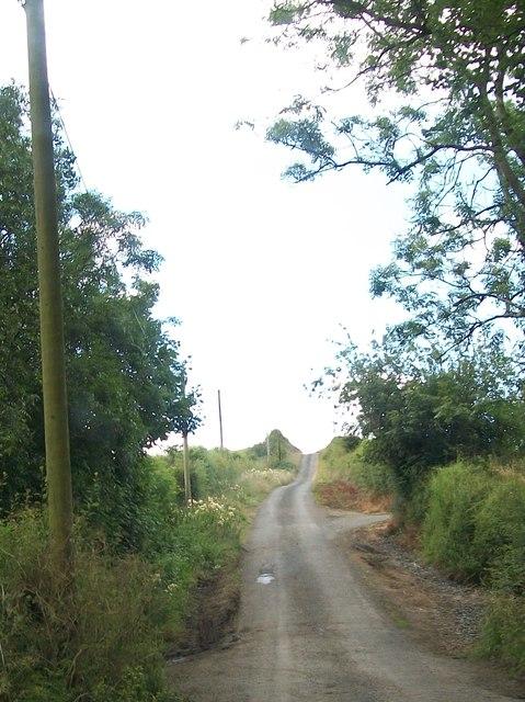 Road ascending a drumlin above Doohallat