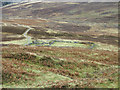 NN7454 : Sheepfold beside path for Schiehallion by Trevor Littlewood