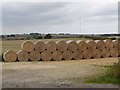 TF2279 : Straw bales at Mousehole Holt by Oliver Dixon