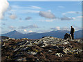 NN5165 : Climber at summit of Sron a' Chlaonaidh by Trevor Littlewood