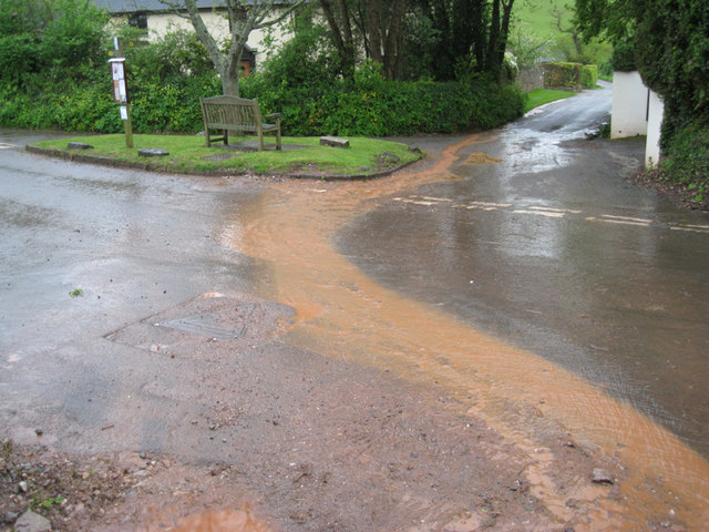 Red run-off from Linacre Lane after rain