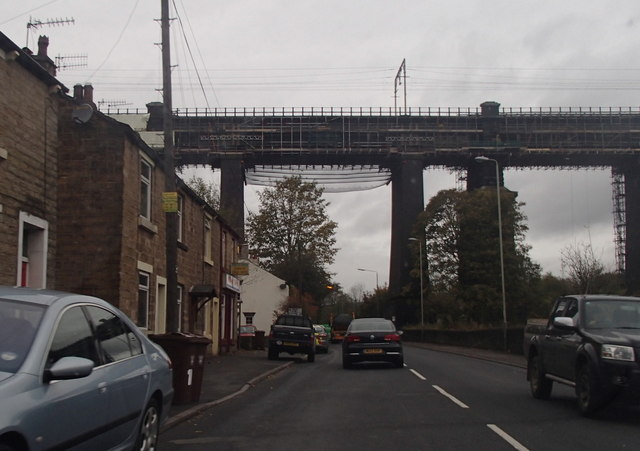 Railway viaduct and the A57 in Dinting Vale