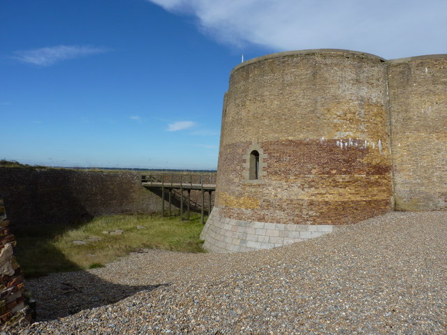 The breached outer defences of the Martello tower
