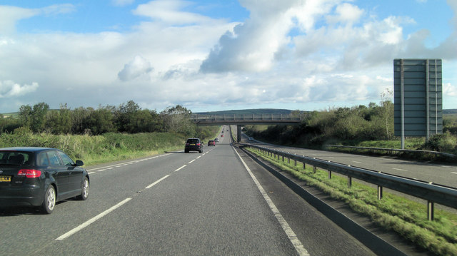 A30 crossed by footbridge from Pengorse Farm