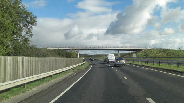 A30 crossed by footbridge from Trewin Farm