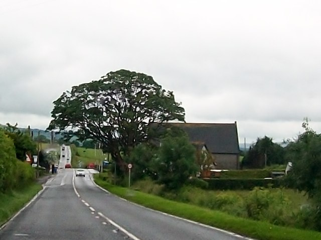 The A5 approaching St John's (Church of Ireland) Church, Dunnalong, Bready