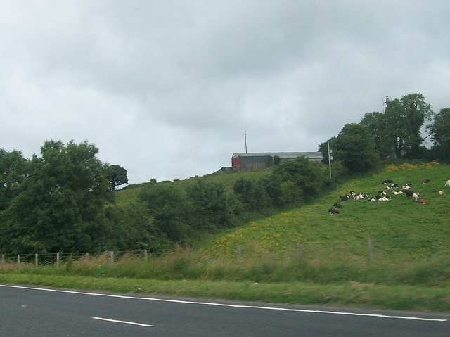 Farm buildings on the summit of a drumlin above the A4 (Snowhill) road