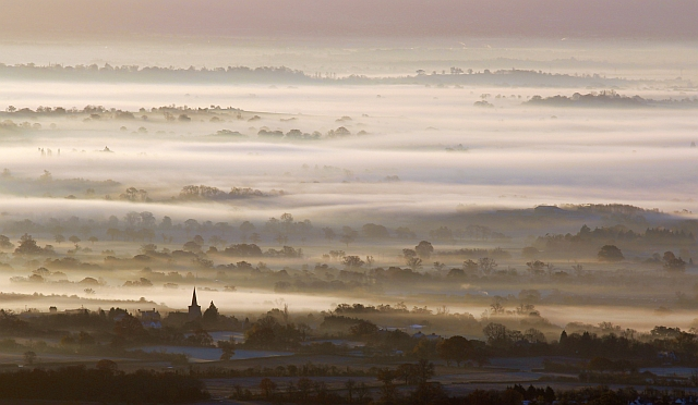 Castlemorton church with mist over Longdon Marsh