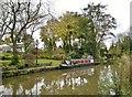 SJ9380 : House beside Macclsefield Canal + narrow boat by Chris Morgan