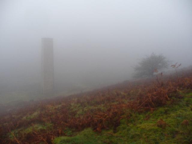 Old chimney in the hill fog in Cwm Byrgwm