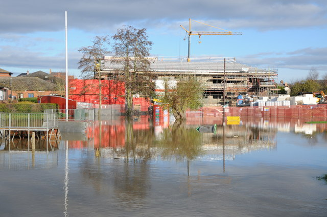 Construction work reflected in floodwater