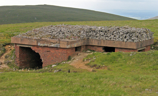 Brick-built, ruined building on slope of Tinside Rigg