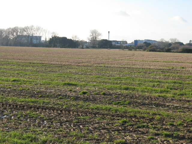 View across stubble field to Industrial Estate