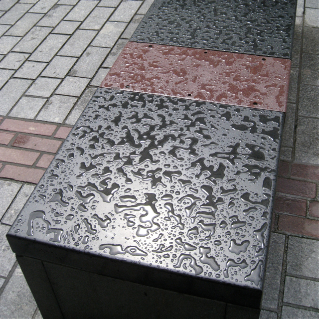 Polished stone bench after rain, Eastgate