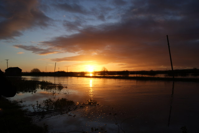 Sunrise over flooded fields and River Yeo