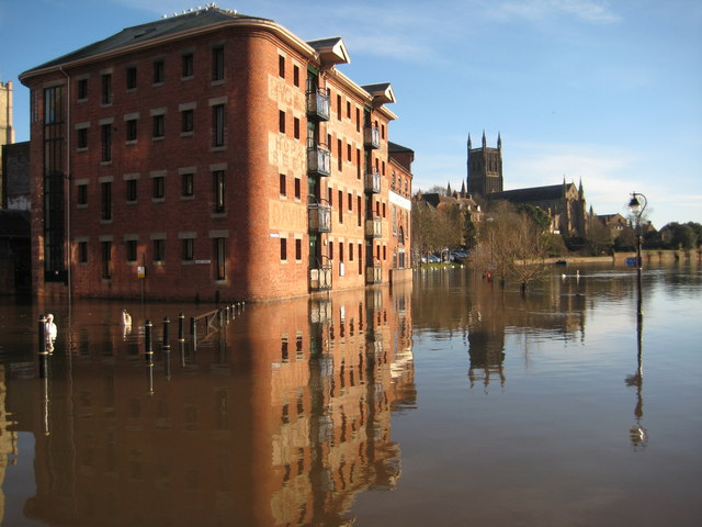 Former warehouse and Worcester Cathedral reflected in floodwater