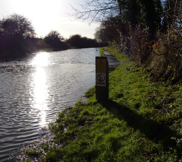 The flooded towpath of the Grand Union Canal