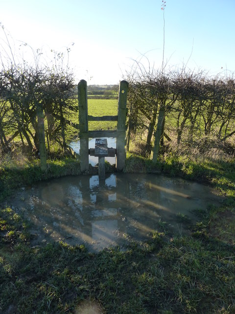 Stile with water feature