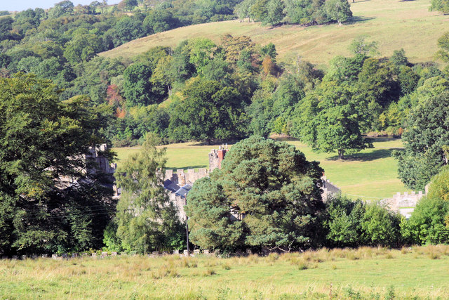 Featherstone Castle through the trees