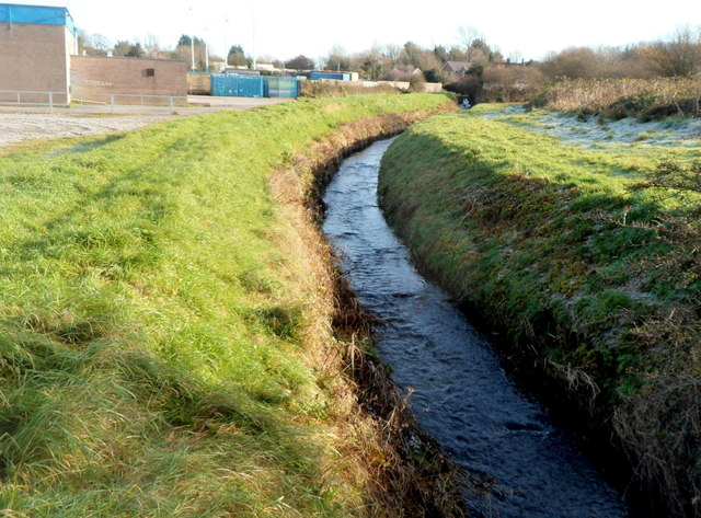 Afon Fach flows towards Pyle railway station footpath