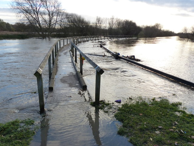 Weir along a flooded Grand Union Canal