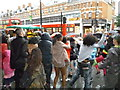 TQ3175 : Dancing in the rain, Brixton Road SW9 by R Sones