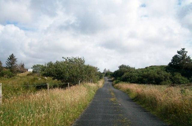 The road to Cloughwally climbing south-eastwards across the flank of Drumlaghdrid Hill