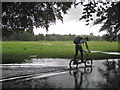 SP2965 : Bike, flooding and rain, St Nicholas Park: 1 by Robin Stott