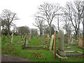 NT9954 : Propped up headstones in Berwick Cemetery by Graham Robson