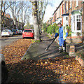 SP2865 : Blowing leaves off the footway, Broad Street CV34 by Robin Stott