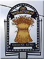 TL7911 : The Wheatsheaf inn sign by Robin Webster