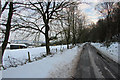 SJ9062 : The Cloudside road with Wood Common Farm buildings by Peter Turner