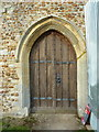 TL2445 : All Saints Church, Eyeworth, Doorway by Alexander P Kapp