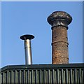 SK4833 : Chimneys old and new by David Lally