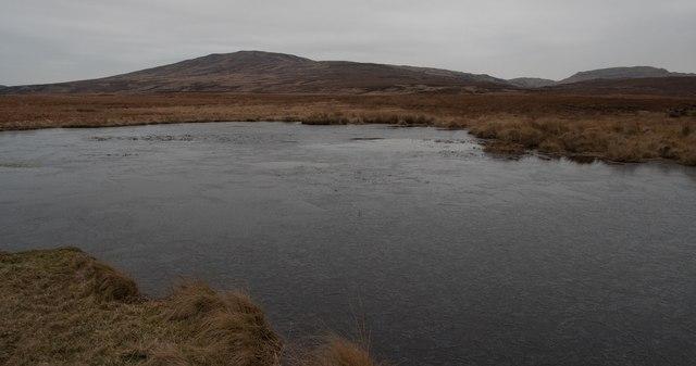 Tiny frozen lochan north of Gortantoid, Islay